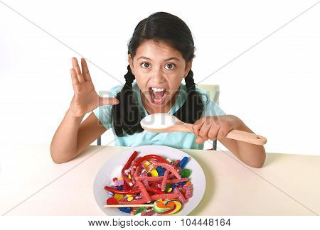 Crazy Spastic Child Eating Dish Full Of Candy Holding Sugar Spoon In Dangerous Diet And Sweet Nutrit