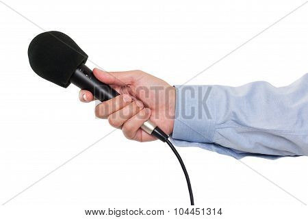 Person's hand holding a microphone