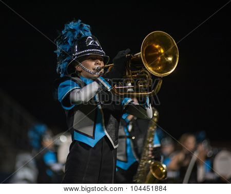Marching band putting on show at football game.