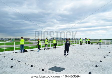 Spotting Fans Take  Picture Of Moving Plane On The Territory Of Pulkovo International Airport In Sai