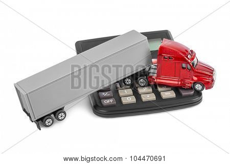Calculator and toy truck car isolated on white background
