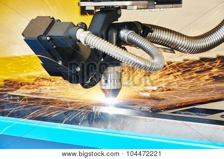 metal working. Plasma or Laser cutting technology of flat sheet metal steel material with sparks