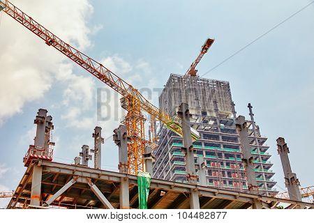 Skyscraper Building Under Construction In Summer Day.