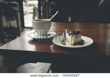 Hot Cappuccino Coffee That Serve With Blueberry Cake