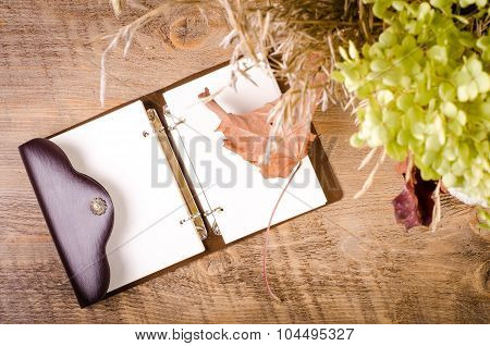 Autumn bouquet  with diary on wooden table