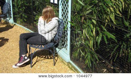 Girl/Teenager Sitting Alone Enjoying The Sun