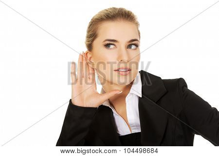 Young blonde businesswoman overhears gossip.