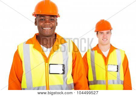 happy african blue collar worker with colleague on background