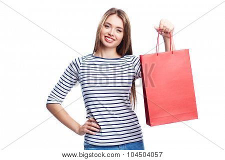 Young shopper with red paperbag looking at camera
