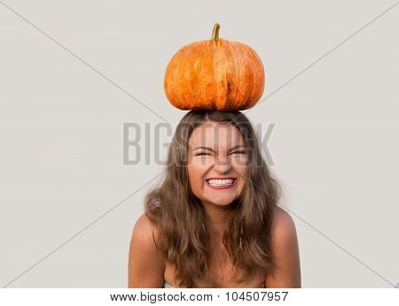 Giggling Beautiful Girl With Halloween Pumpkin On Her Head