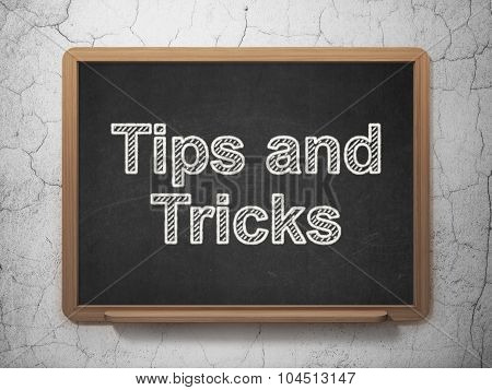 Learning concept: Tips And Tricks on chalkboard background