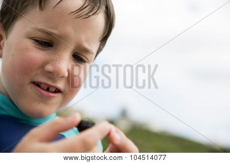 Little Boy with a beetle