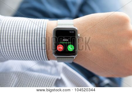 Man Hand With Apple Watch And Phone Call On Screen