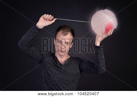 man blowing a water balloon