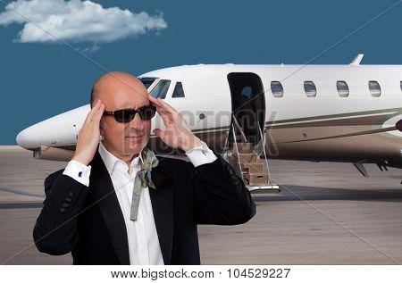 Man in a tuxedo expressing discomfort