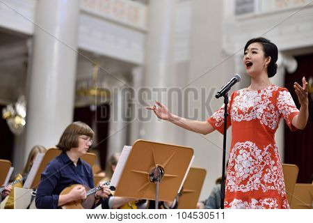ST. PETERSBURG, RUSSIA - OCTOBER 6, 2015: Soprano Yui Don Ni from Star Sopranos of China on the rehearsal with the Andreyev State Russian Orchestra during the Festival of Chinese music
