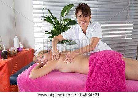 Female Therapist Ging A Massage To A Young Woman