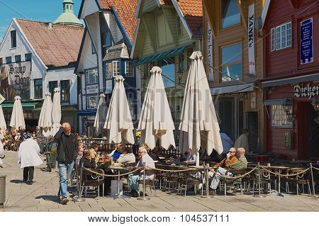 People relax in a street cafe in downtown Stavanger, Norway.