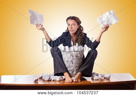 Woman with lots of discarded paper poster
