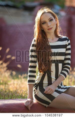 Beautiful young redhead outdoors