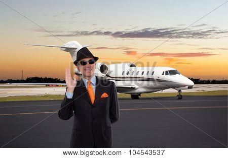 Business man waving near a private jet poster