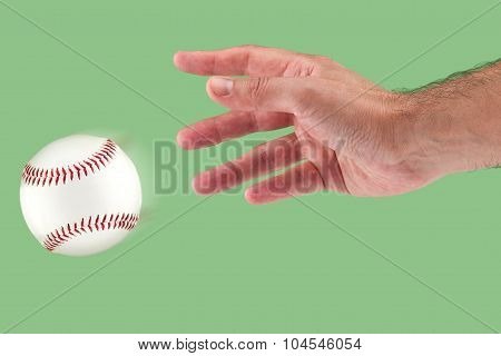 A hand throwing a baseball