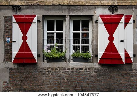 Authentic wooden red & white shutters on a medieval house