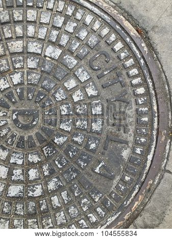 City of L. A. Sewer Manhole Cover on the Street.