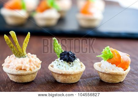 Variety Of Savory Mini Pastry Tartlets.