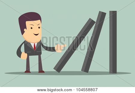 Businessman toppling dominoes.