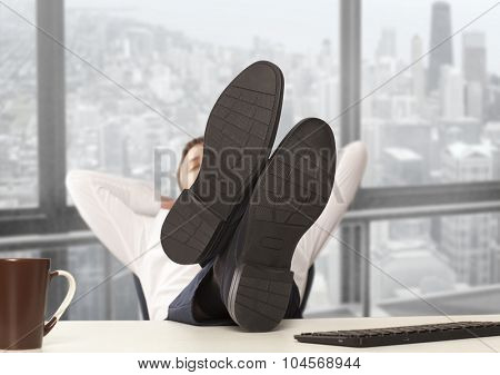 Weary businessman sitting in a chair, and solves the problem