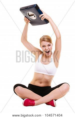 Slimming diet weight loss. Upset frustrated angry young woman girl screaming shouting and throwing weighing scale. Healthy lifestyle concept. Isolated on white background. poster