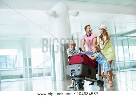 Family with a suitcase at the airport
