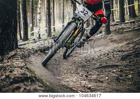 athlete mountainbiker rides on a u-turn