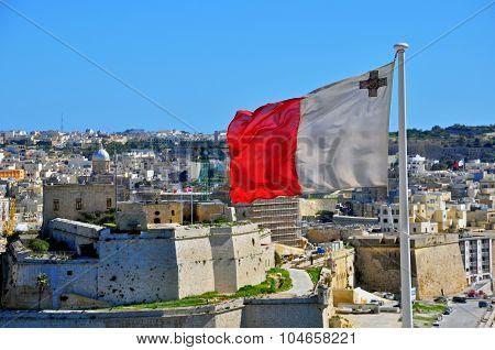 Maltese flag and Senglea (Isla) cityscape, Malta poster