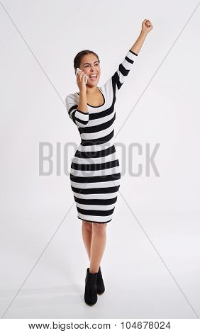Stylish Woman Cheering As She Chats On Her Mobile