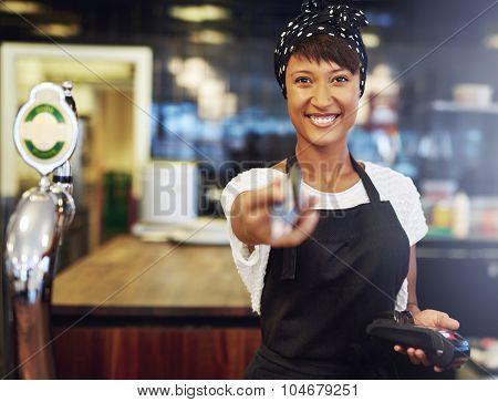 Vivacious Bar Tender Handing Back A Card