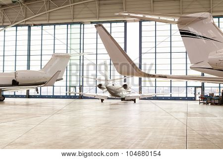 Small Passenger Airplane Leaving Bright Hangar