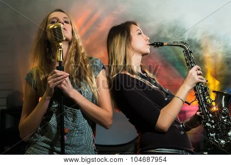 Young pretty women with saxophone