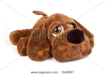 sad puppy toy with big eyes over white background poster