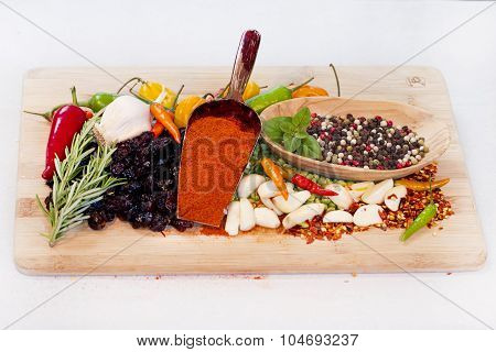 Spices and Herbs on a Cutting Board