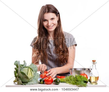 Young Woman Cooking In The Kitchen. Healthy Food - Vegetable Salad. Diet. Dieting Concept. Healthy L