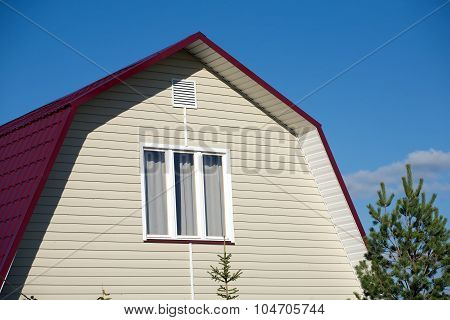 New country house with beige siding