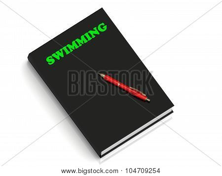 Swimming- Inscription Of Green Letters On Black Book