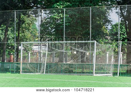 Vacant football goal at outdoor stadium in midnoon