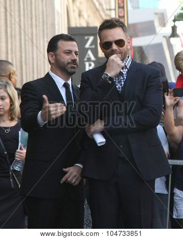 LOS ANGELES - OCT 12:  Jimmy Kimmel, Joel McHale at the Kelly Ripa Hollywood Walk of Fame Ceremony at the Hollywood Walk of Fame on October 12, 2015 in Los Angeles, CA