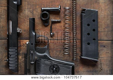 Dismantled Handgun