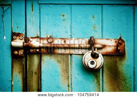 Lock On Blue Wooden Background