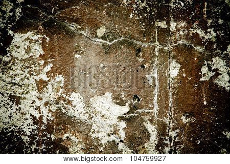Dark stone background with lots of imperfections and cracks