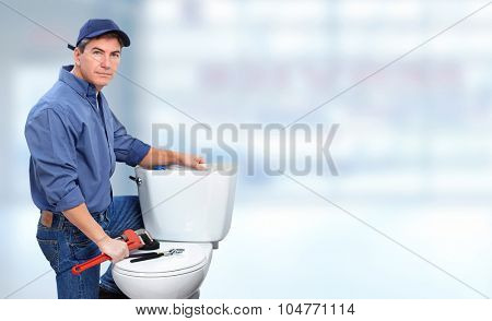 Plumber repairing toilet. Plumbing and renovation banner.